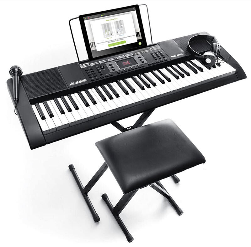 electric piano keyboard music stand speakers headphones