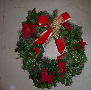 Lots and lots of fake green Christmas wreaths, garlands $ 5-$ 15