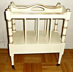 A vintage magazine rack with drawer & casters, solid wood