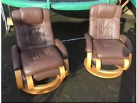 Pair of brown leather look reclining chairs with foot stools