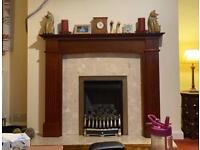Coal effect gas fire with surround