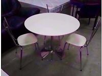 White dining table with three chairs