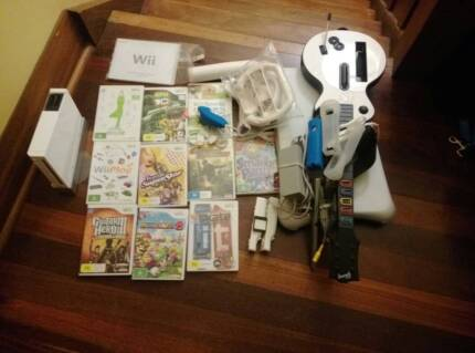 NINTENDO Wii (with 10 games, Wii Fit, and Guitar Hero)