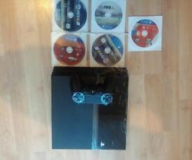 Sony PlayStation 4 Ps4 console with 5 games
