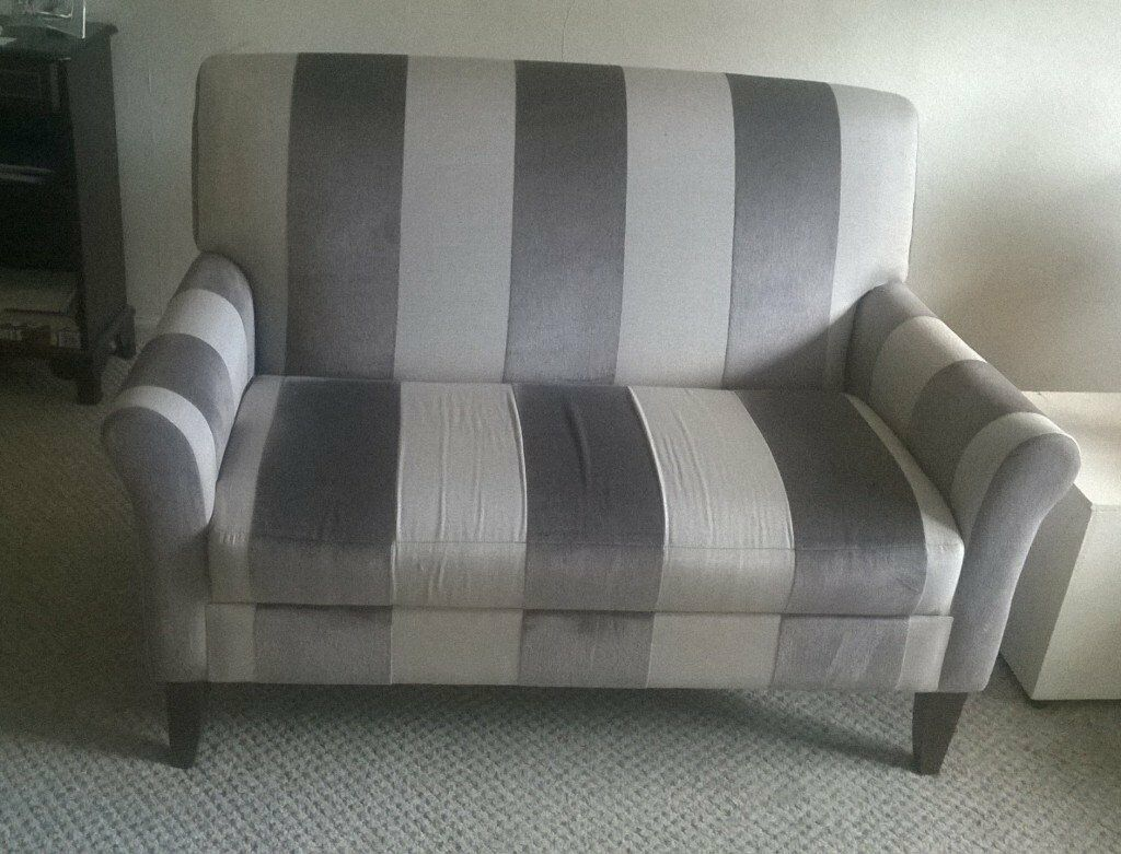 brown and cream 2 seater sofas