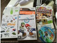 Wii with games and fit board