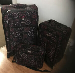 Never used 3 piece suitcase with locking mechanisms