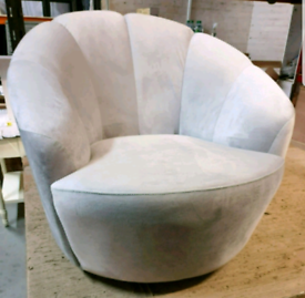 A new stylish light grey soft touch fabric arm chair.
