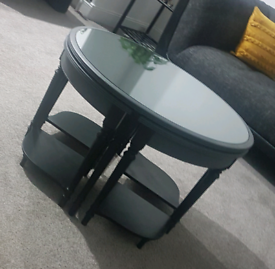 Coffee table with four tucked in tables