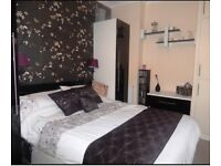 Bedroom Furniture. Wardrobes, double bed and chest of drawers. Black gloss and white