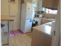 Huge double room in Barnes available now with king bed, sofas, fridge, Tv, balcony, 10min barnes St.