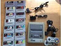 SNES Console, 2x Controllers, 14 games
