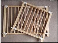 Pair of matching wooden stair gates
