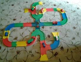 Early learning racing track including vans and cars in exellent condition