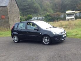 **Ford Fiesta Ghia 1400 TDCI. - Black, cream leather interior. Low running costs & ex condition**