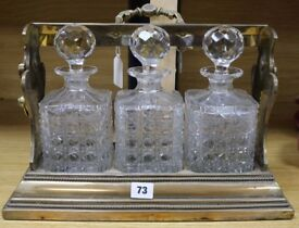 A Betjemanns Victorian three bottle tantalus with key circa 1880s