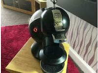 Hardly used Nescafe dolce gusto coffee machine with 2 box pods for £20