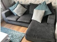 **Excellent Condition**DFS 3 Seater Corner Sofa with matching Arm Chair and Ottoman, in Grey.