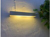 habitat wall light fitting including tube