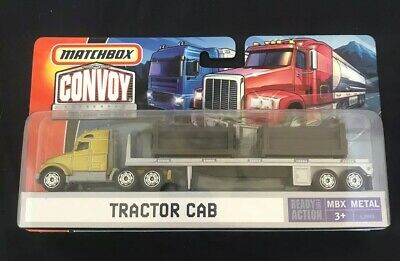 Matchbox Convoy ~ Yellow Tractor Cab Hauling Pipes ~ 1:64 MBX Die Cast (NEW)