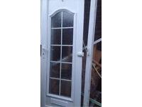 WHITE PVC EXTERIOR FRONT DOOR.