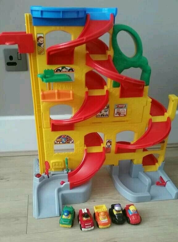 Toy racing track with 5 cars