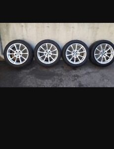 BMW authentic rims and tires 245/45/18 winter package  West Island Greater Montréal image 1