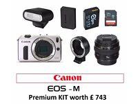 Canon EOS M Silver 18MP,+ Speedlite , 2 Batteries, 32 GB SDHC Card+ Adaptor + option EF 50 mm f 1.4
