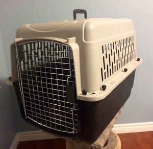 Dog Kennel, (28x22x21), Used Once for oneway flight