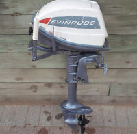5 hp 2 stroke evinrude outboard motor + 4 person inflatable boat
