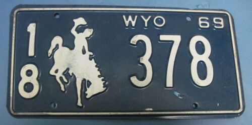 1969 Wyoming License Plate all original with cowboy very good