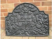 Antique Cast iron plaque or fireback with coat of arms motif and date 1631.