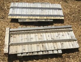 2 sections of low closeboard wooden fencing