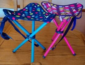 pair of colourful fold up camping stools.