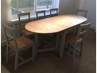 Solid pine dining table and 6 chairs in light antique stain/ grey