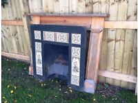 Cast Iron and Ceramic Tile Fireplace with Wooden Surround