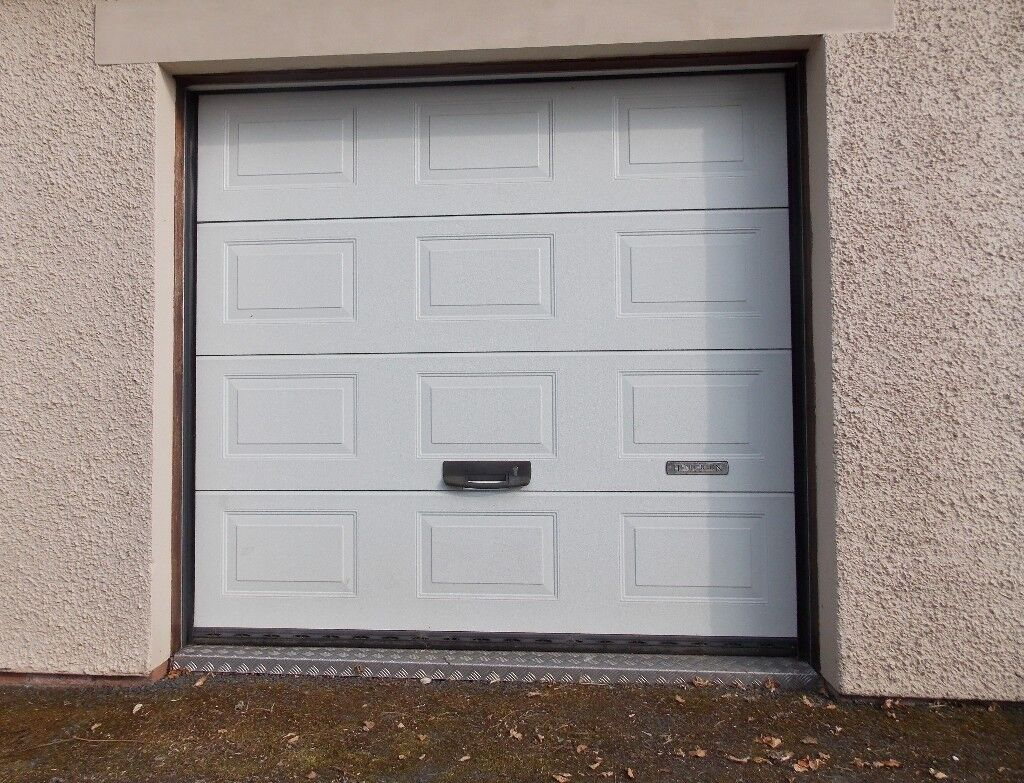 Pair Of Henderson Insulated Electric Garage Doors From