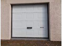 Pair of Henderson insulated electric garage doors