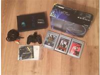 Boxed PS2 console with games