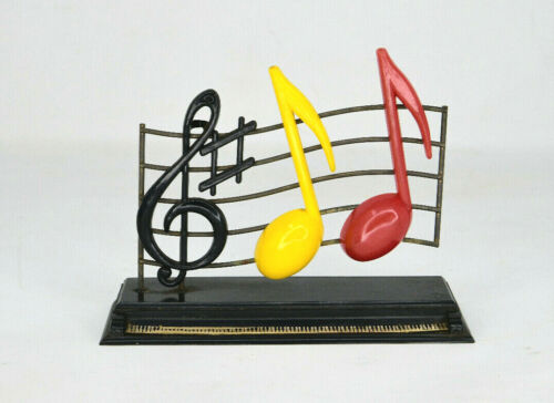 Vintage Plastic Musical Notes Over A Piano Figural Salt And Pepper Shakers