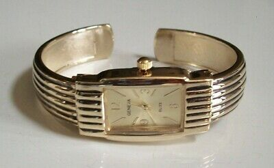 CHARMING LADIES WESTERN STYLE GOLD FINISH BANGLE CUFF FASHION CASUAL WATCH -