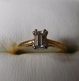 Woman's engagement ring in 18ct gold with 0.26ct diamond and a man's wedding ring in 18ct gold