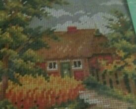 New tapestry kit of a country cottage in a flower garden and country path.