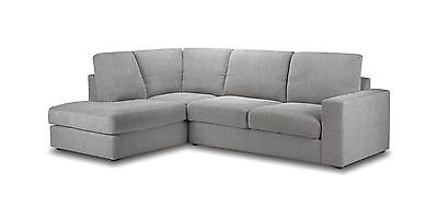 Look for a grey, fabric sofa you can dress up
