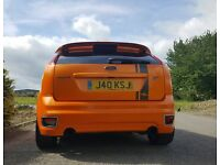 Focus ST2 2006. Good condition. Orange and stunning.
