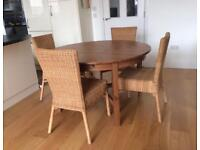 Solid Wood, round extending Dining Table and 6 Wicker Chairs for Sale