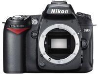 NIKON D90 with Nikkor 28-80mm lens with battery grip