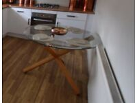 Glass dining table with real oak legs