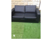 Used double black leather sofa bed