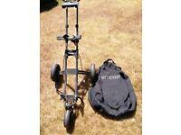 Motocaddy Push golf trolley with zipped travel bag.